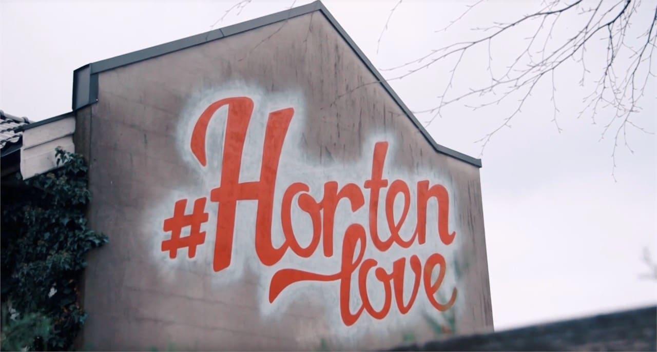 Bilde av Hortenlove-logo på husvegg